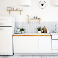 Kitchen decorating ideas with unique modern wall clock and tiny hexagonal backsplash tiles