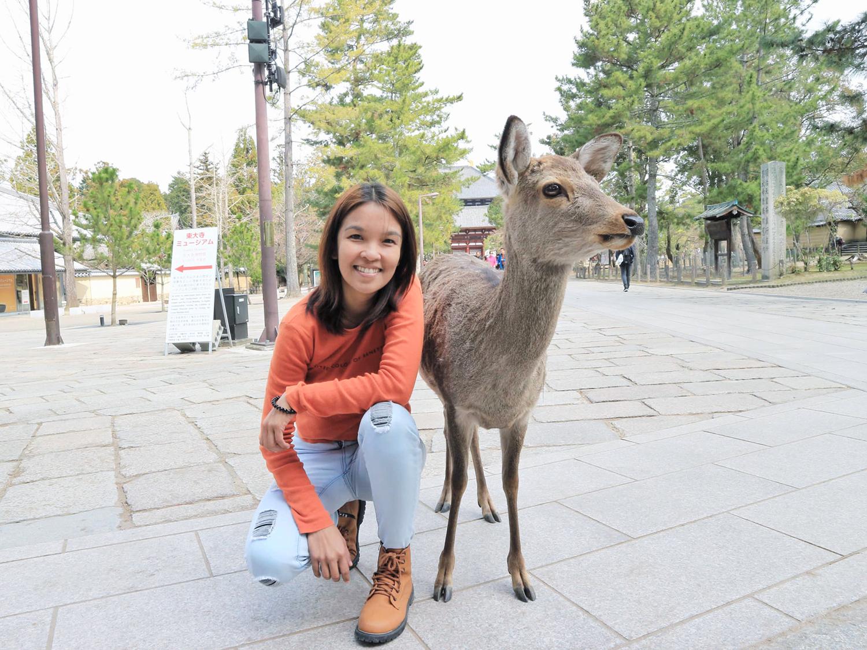 Posing with a deer at Nara Park