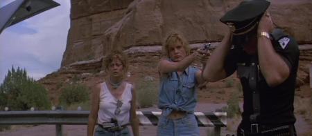 Thelma (Geena Davis) takes control when Louise (Susan Sarandon) runs out of ideas in THELMA & LOUISE (1991).