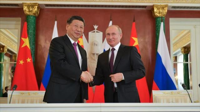 Dólar cae a un mínimo histórico en comercio entre Rusia y China