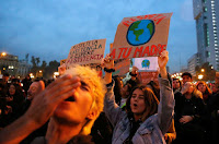 Demonstrators take part in a protest against climate change in Santiago (Credit: © Reuters/Rodrigo Garrido) Click to Enlarge.