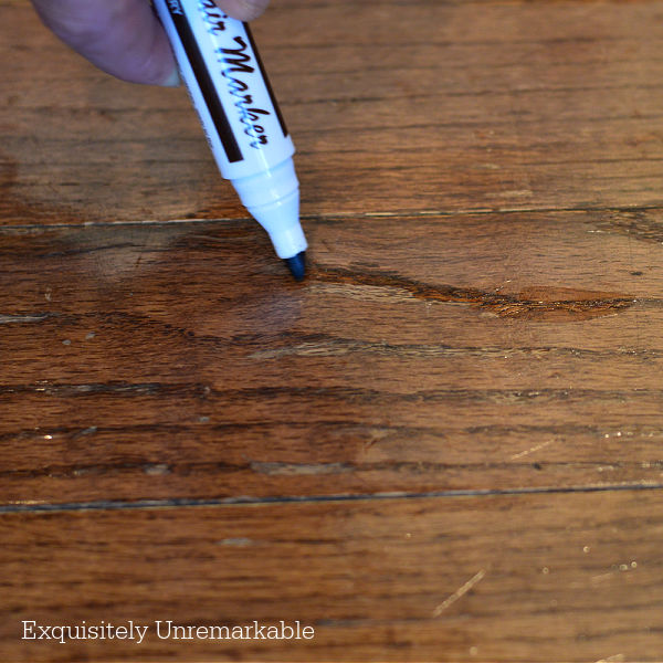Fixing A Damaged Wood Floor With A Furniture Marker