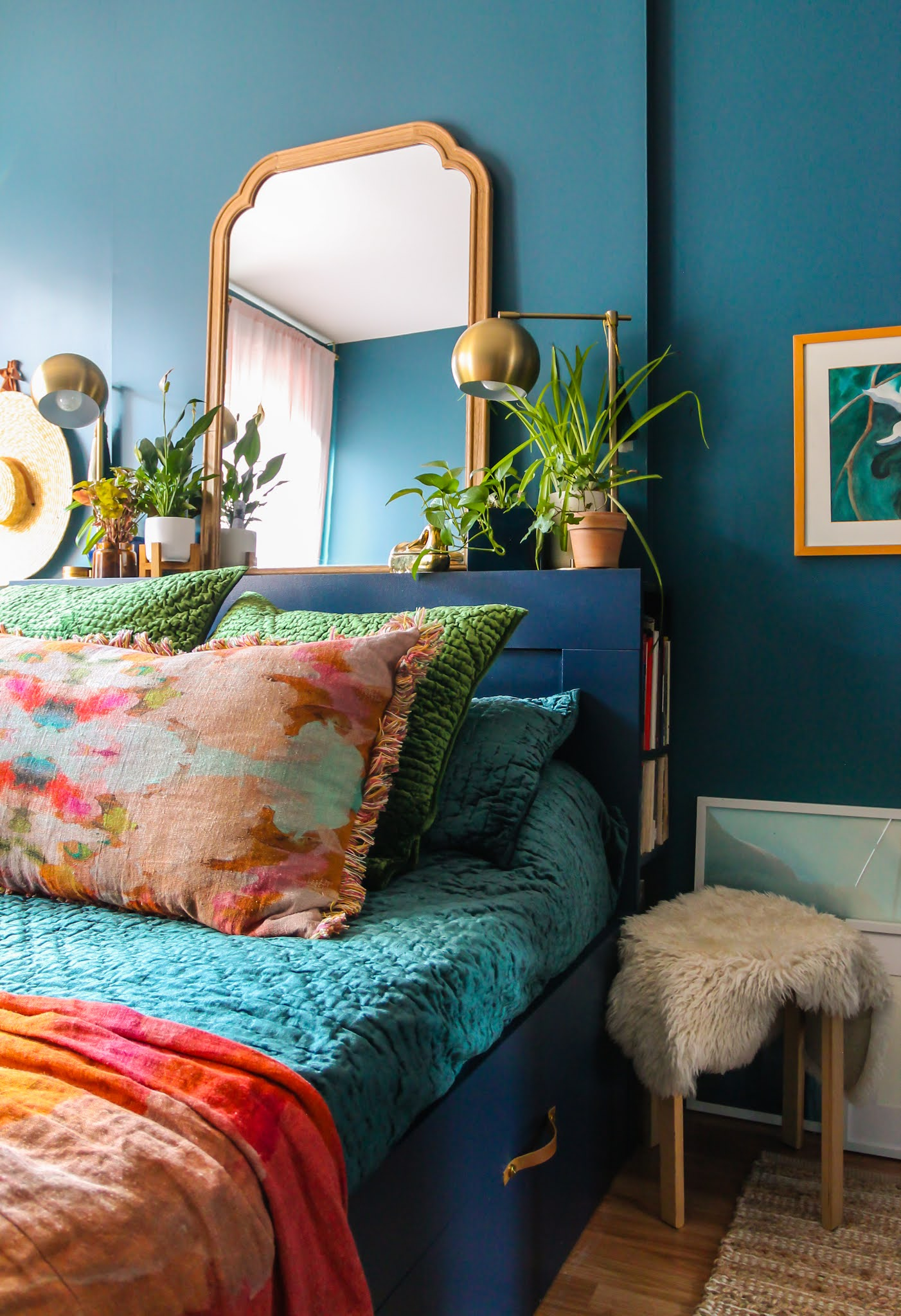 Jeweltone bedroom inspo // bedrooms with plants // moody bedrooms // how to add color to your home // colorful home inspo // blue bedroom // bedroom with plants on headboard // plant headboard // ikea brimnes bed // easy Ikea hacks