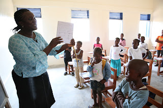 Teacher Elizabeth Toe teaches class at Billy Town Primary in Brewerville, Montserrado County, Liberia