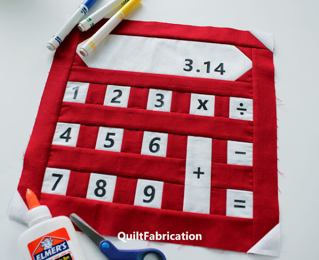 red calculator quilt block with numbers and function keys by QuiltFabrication