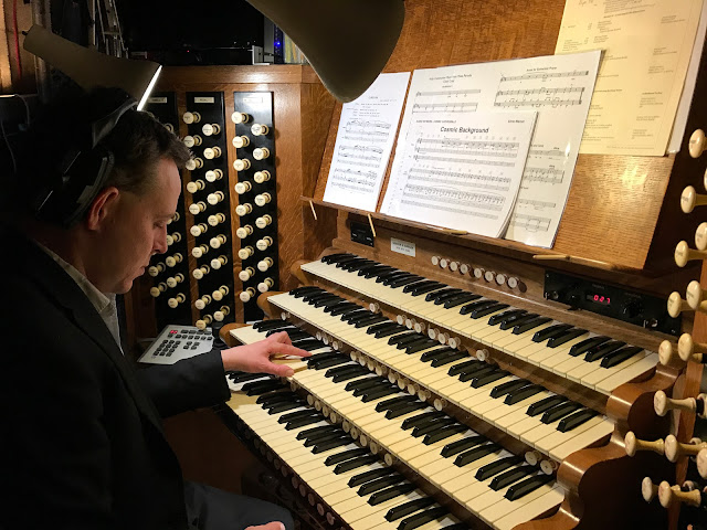Edmund Aldhouse recording Chris Warner's Wonders of the Cosmos at the organ of Ely Cathedral