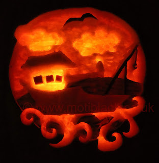 Fishing boat carved onto a pumpkin
