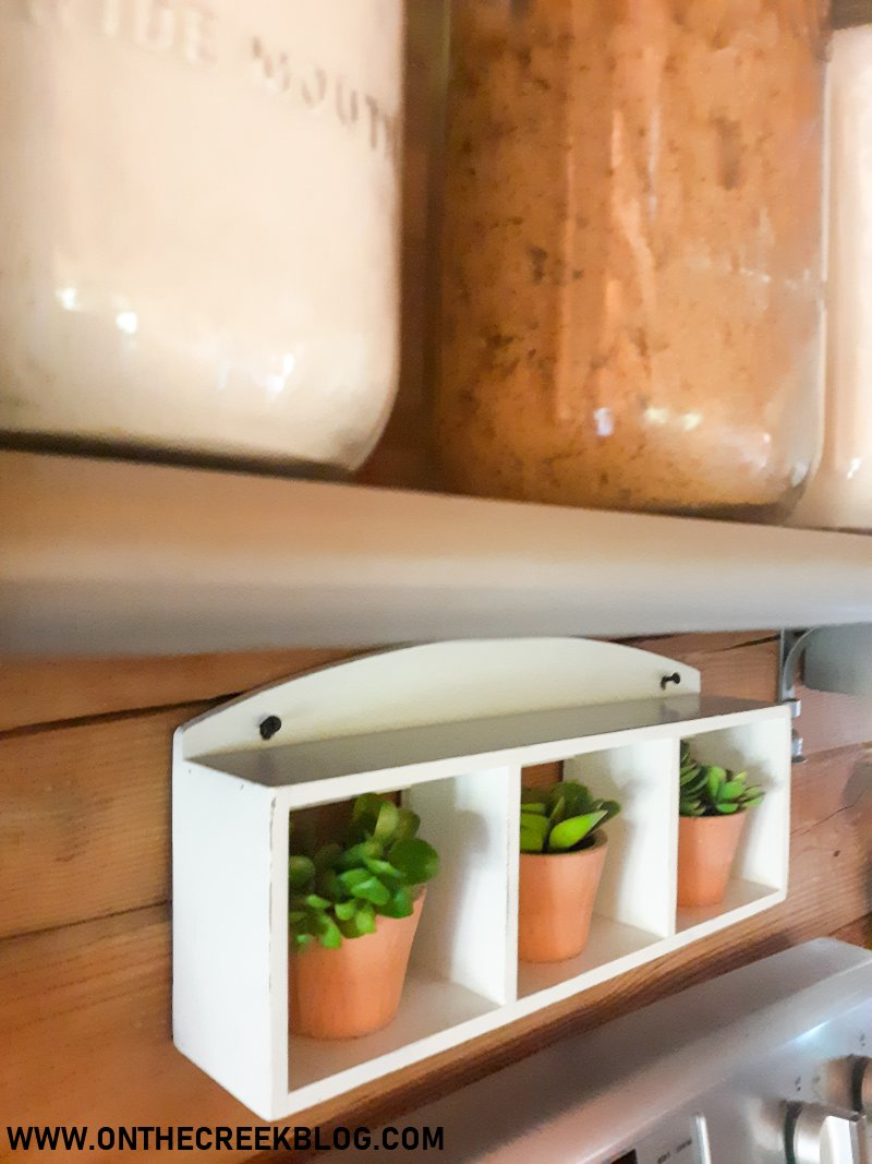A small shelf gets a white chippy makeover with chalk paint! | On The Creek Blog