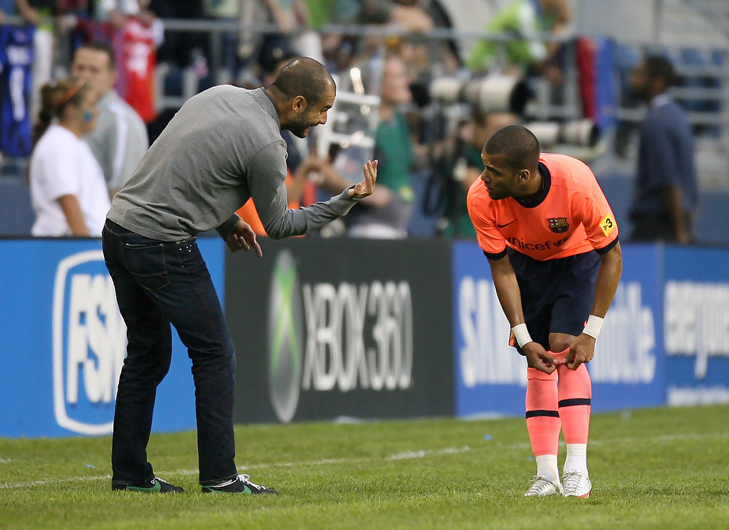 Manager Josep Guardiola of FC Barcelona talks with Daniel Alves #2 during an international friendly match against the Seattle Sounders FC on August 5, 2009 at Qwest Field in Seattle, Washington