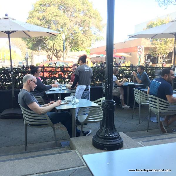 sidewalk seating at Oren's Hummus Shop on Castro Street in Mountain View, California