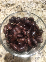 Photo of cooked scarlet runner beans in a glass container bowl. https://trimazing.com/