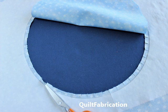 circle cut from background and clipped seam allowance