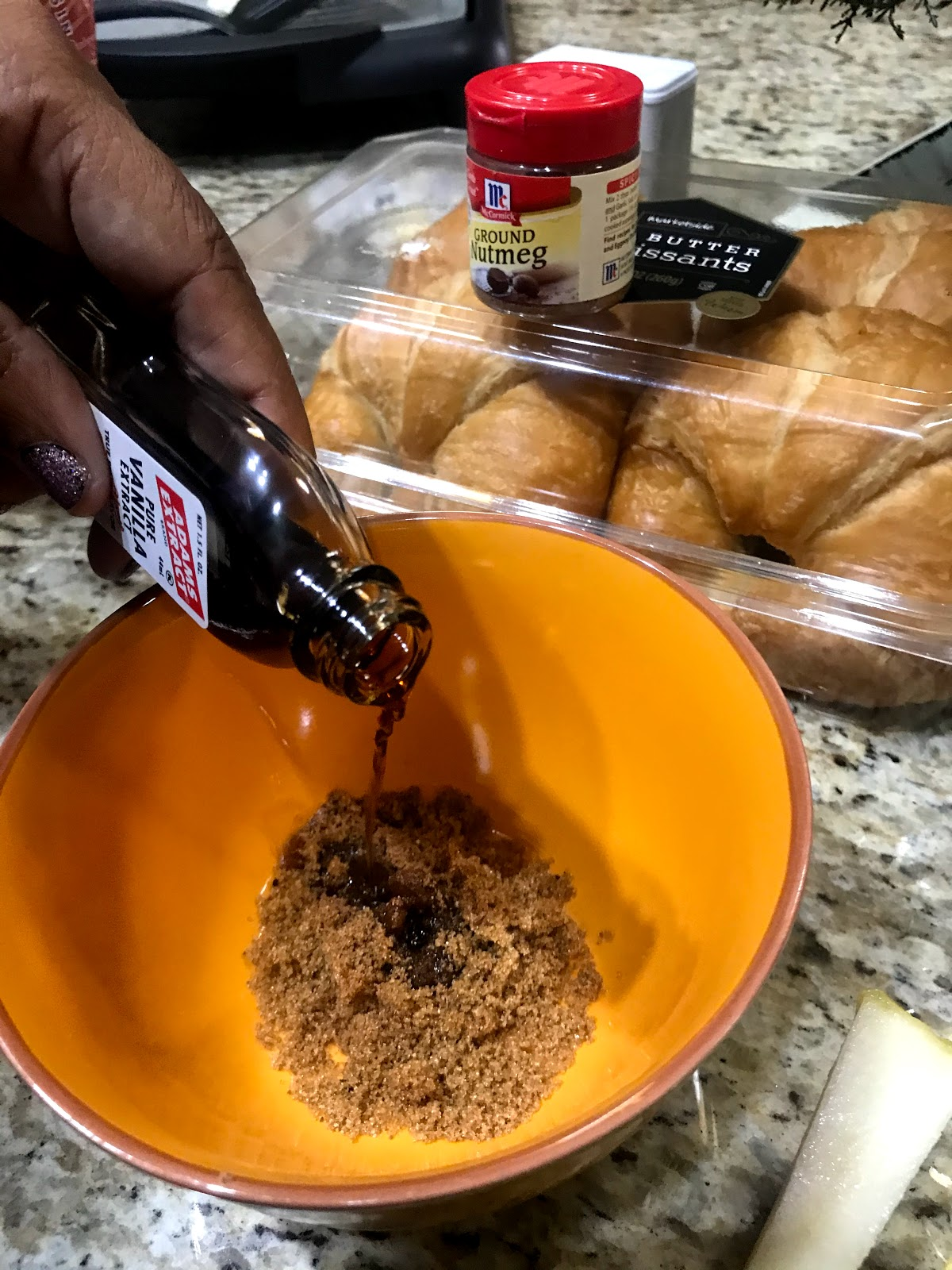Tangie Bell is sharing how she uses, vanilla flavoring, cinnamon, and sugar to make the sauce for her sammich