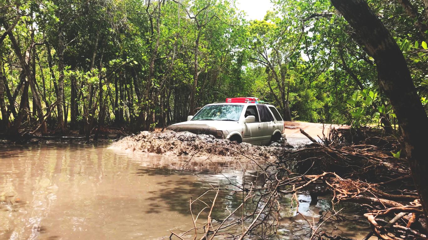 Car driving through muddy water in Yarawonga Park Reserve