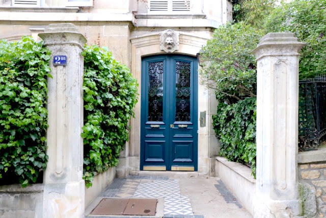 Beautiful blue double doors on private and secret Avenue Frochot in Paris
