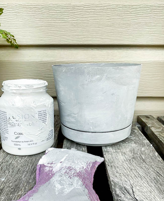 Blend gray and white paint together