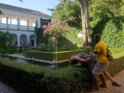 Helping Ainhoa drink water in the palace gardens of the Generalife