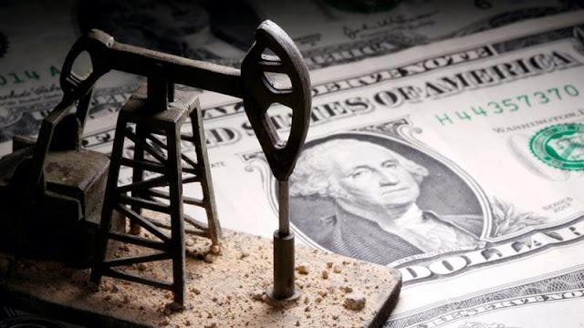 Dólar sube tras caída del petróleo