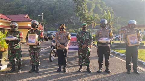 Polres Padang Panjang Bagikan 200 Paket Sembako