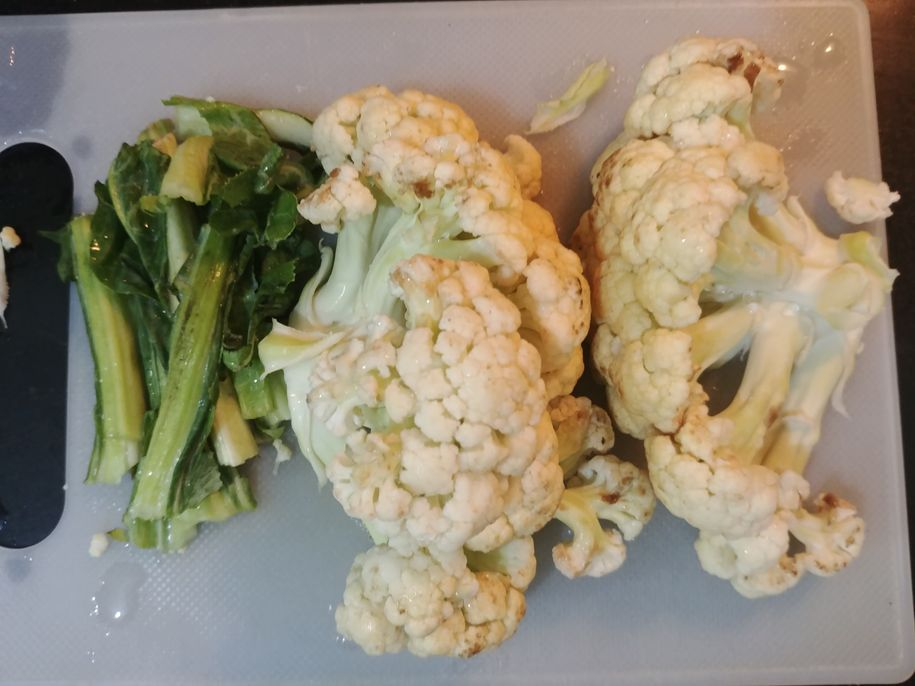 Fresh cauliflower and young leaves to be made into chops