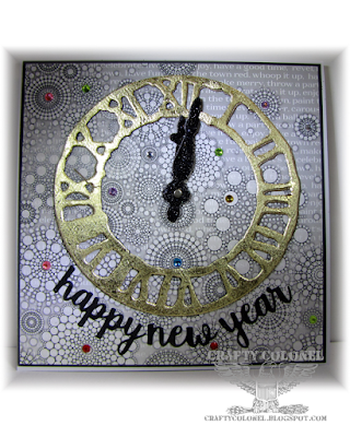 CraftyColonel Donna Nuce for Cards in Envy challenge.  Weathered clock Tim Holtz.  Nuvo flakes technique.