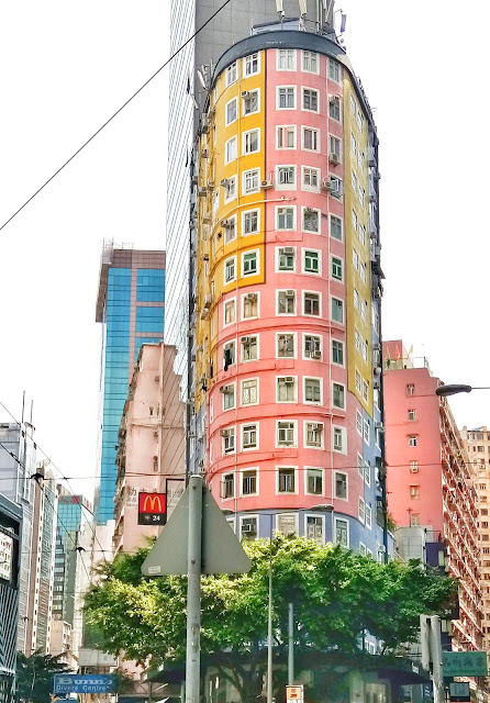 pastel colored vertical buildings in hong kong