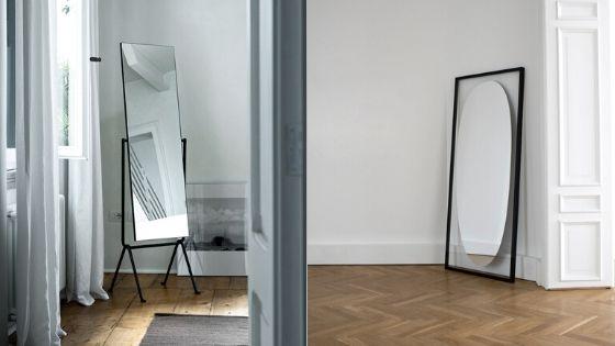 Stojące na ziemi lustro w mieszkaniu