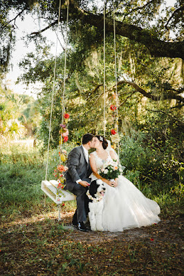 bride and groom on large swing