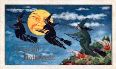 Antique vintage Halloween postcard with witches and a full moon