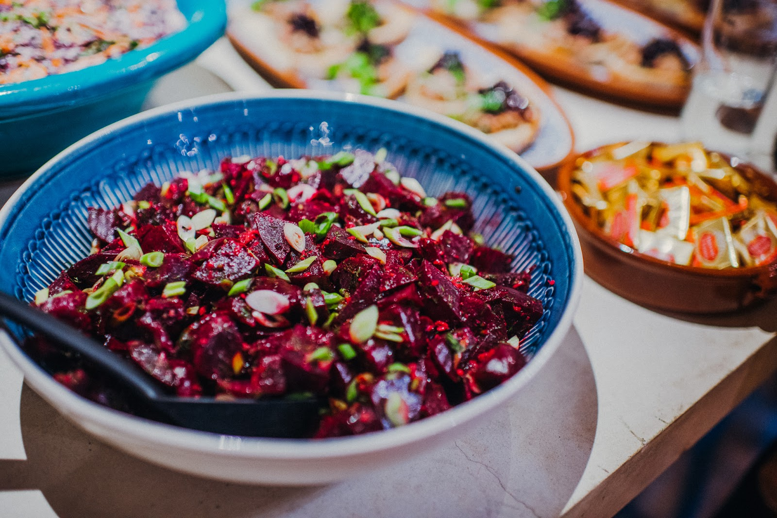 Beetroot salad in a blue bowl.