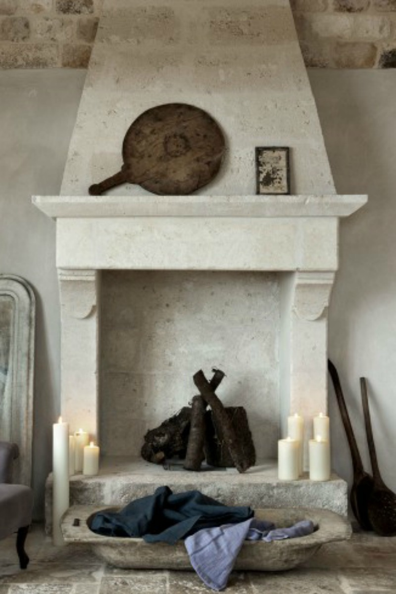 Magnificent plaster and stone fireplace in Italian farmhouse - found on Hello Lovely Studio