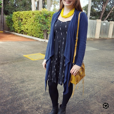 awayfromtheblue instagram tiered sundress in winter with ankle boots tights cardigan yellow accessories