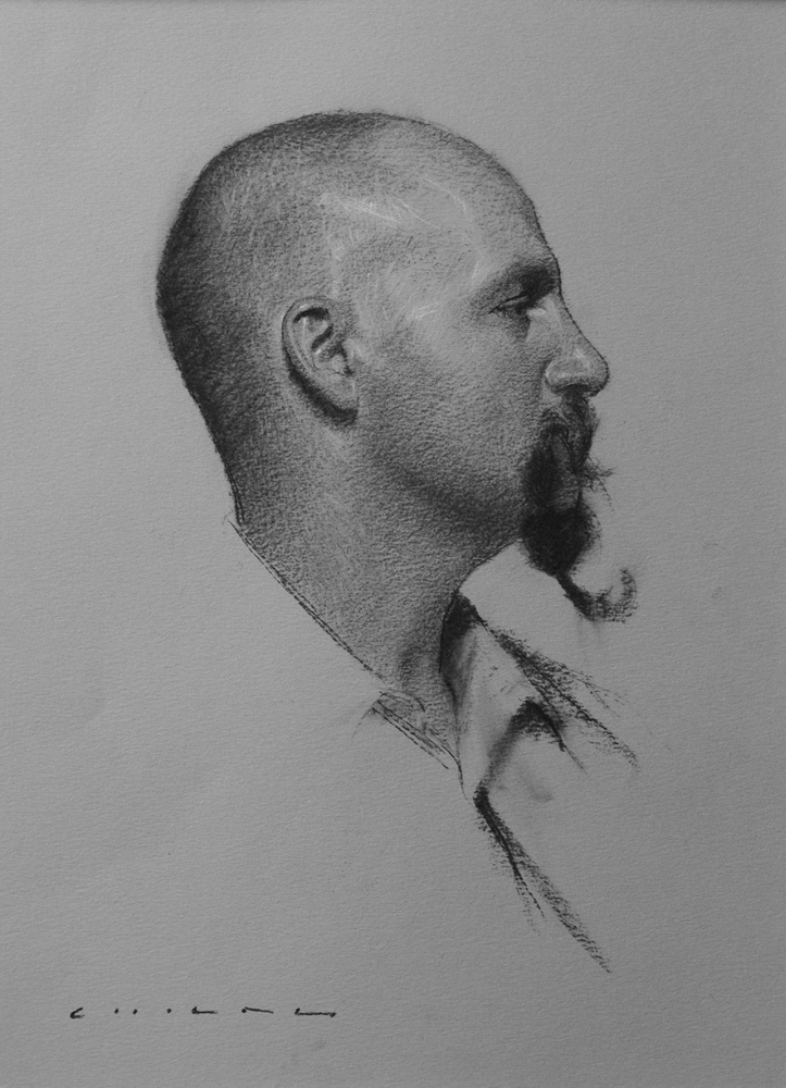 01-Ivan-Casey-Childs-Charcoal-Portrait-Drawings-that-Capture-our-Essence-www-designstack-co