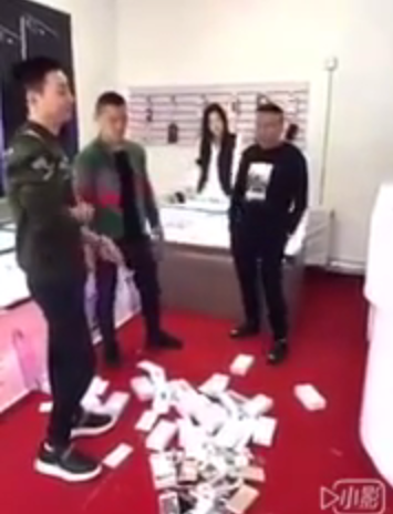 Photos & Video: Man Buys And Destroys 15 Iphones Because The Sales Rep Didn't Address Him Well