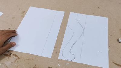 تصميم جانبي لرجل كرسي على ورقة بيضاء