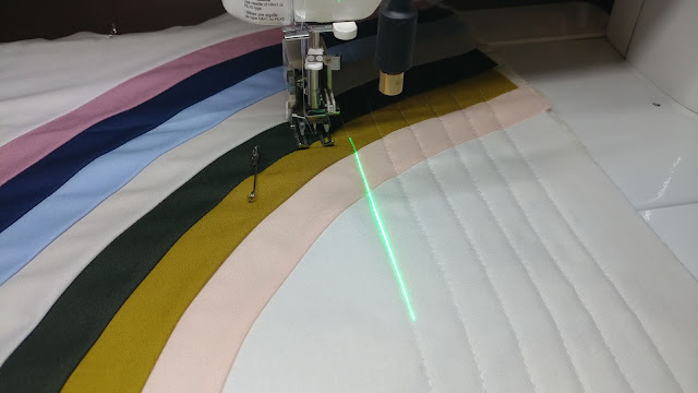 Using a sewing machine laser for straight line quilting