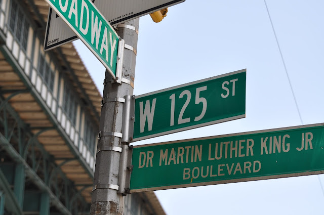 Street signs for W 125 st.