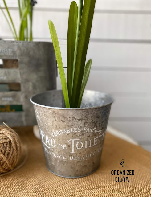 Photo of small galvanized pot with faux plant