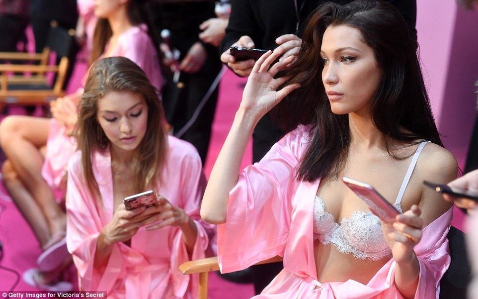 Models put on busty displays backstage at the 2016 Victoria's Secret Fashion Show in Paris
