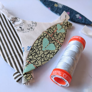 epp shapes and a spool of aurifil thread