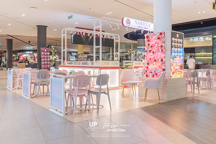 Central i city vanilla mille crepe kiosk overall view in pastel color seating area, gradient pink roses highlighted wall and menu board