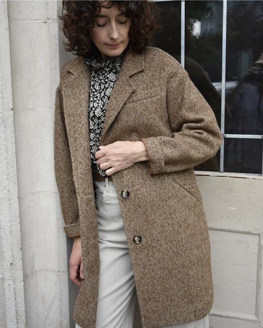 Woman wearing a long brown wool coat