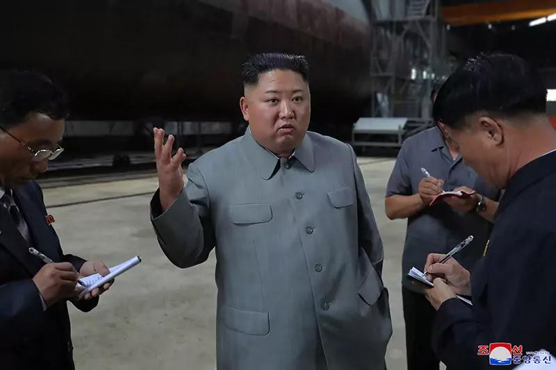 (1) Kim Jong Un inspects newly built submarine, July 2019