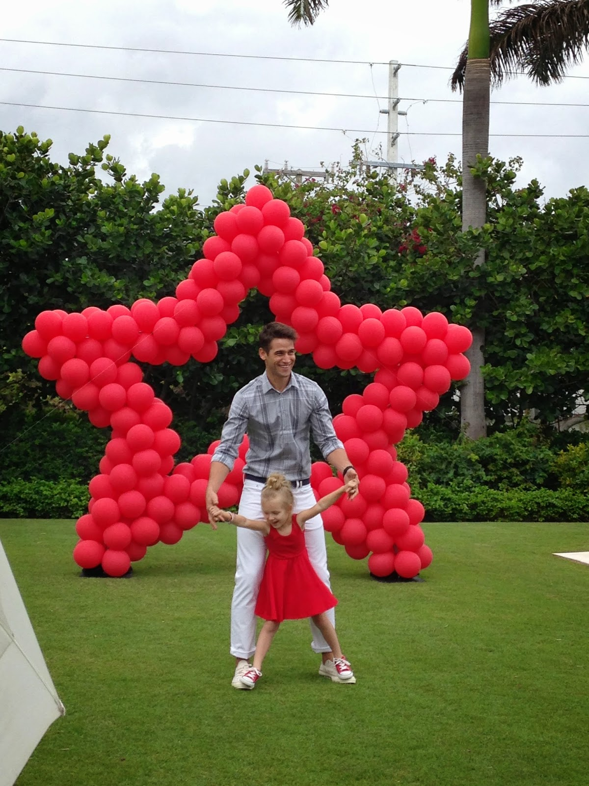 Red star shape by balloons for photoshoot Macy's magazine