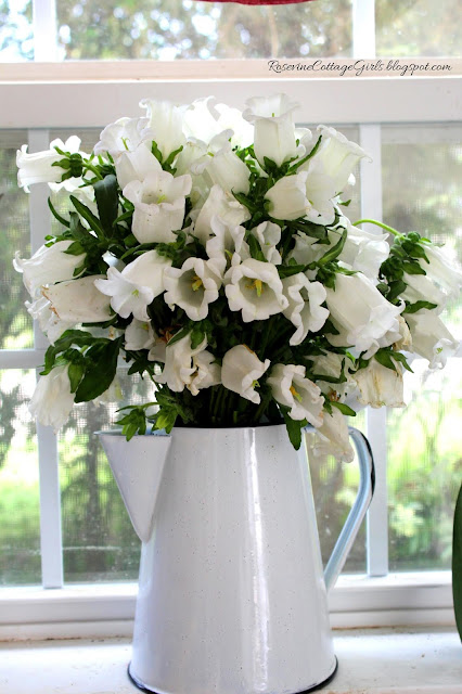 Beautiful farmhouse flower arrangement in old coffee pot