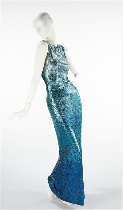 Deep ice blue silk and sequined floor length evening gown designed by Norman Norell displayed on mannequin