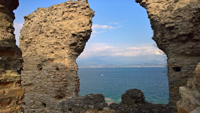 View through the ruins of Grotte di Catulla (Sirmione) onto Lago di Garda.
