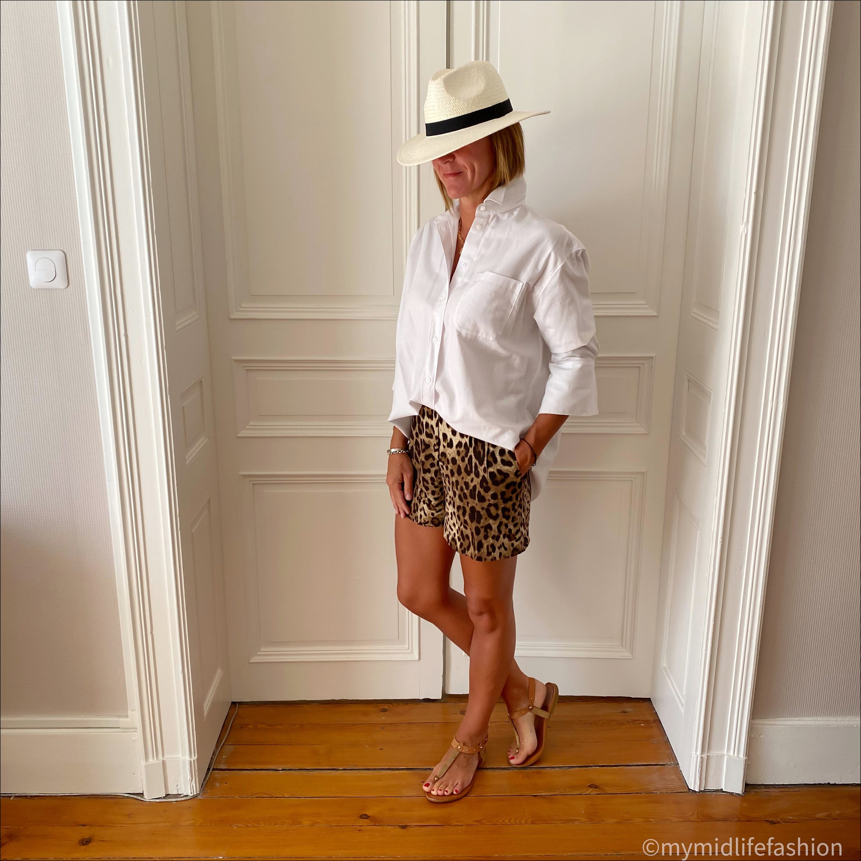 my midlife fashion, and other stories oversized shirt, zara Panama hat, dolce and Gabbana leopard print shorts, Carvela thong flat sandals