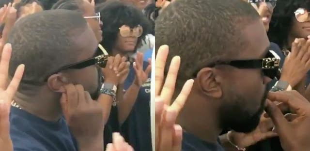 Did Kanye West wear earrings in this video?