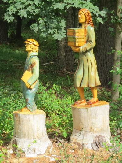 sculptures of school children
